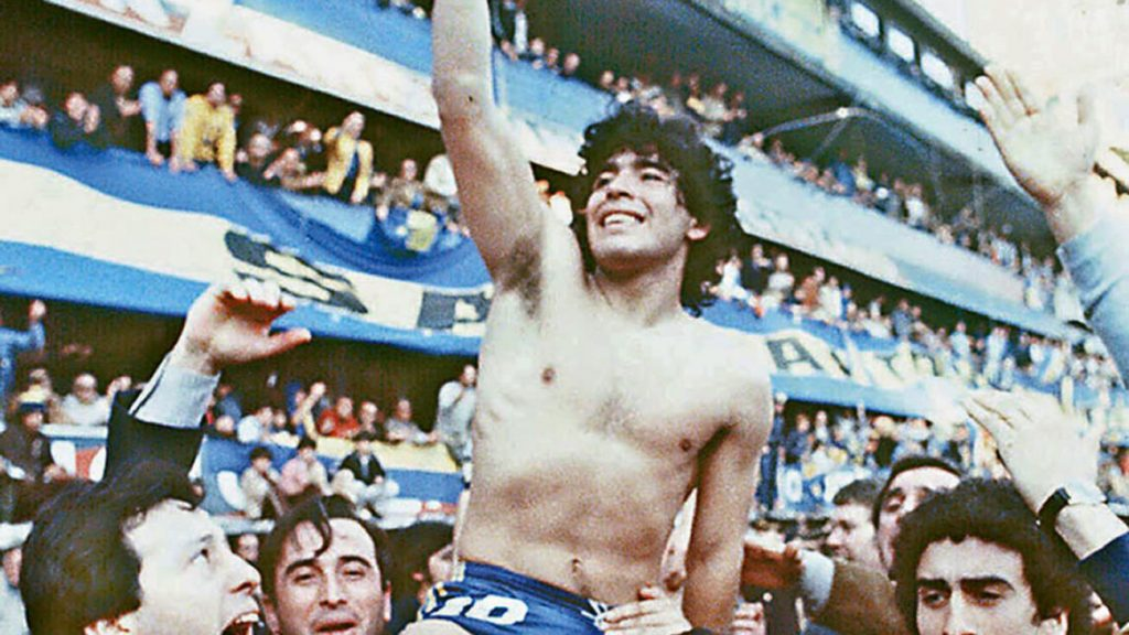 (FILE) This 1981 picture shoes Argentine soccer star Diego Armando Maradona, being carried by fans after winning the 1981 local Championship with Boca Juniors at La Bombonera stadium in Buenos Aires. Boca Juniors, the most popular football club in Argentina, celebrates on April 3rd, 2005, its centenary - from its creation by a group of football enthusiast in a humble neighbourhood of immigrants, until reaching the world's summit, and counting among its supporters with the most famous fan, Diego Armando Maradona. AFP PHOTO/DIARIO POPULAR/NA ARGENTINA OUT (Photo credit should read DIARIO POPULAR/AFP/Getty Images)