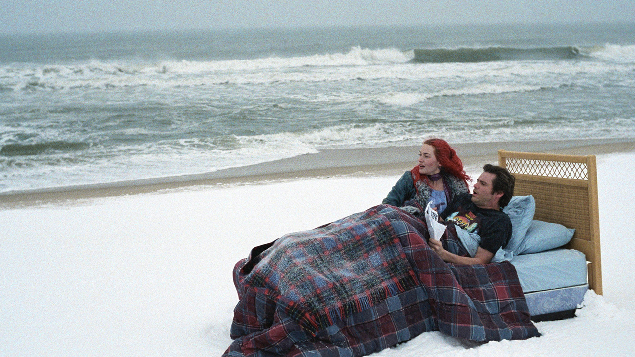 """FILE - In this undated promotional file photo released by Focus Features, actors Kate Winslet, left, and Jim Carrey are seen in a scene from the film """"Eternal Sunshine of the Spotless Mind."""" (AP Photo/Focus Features, David Lee, File)"""